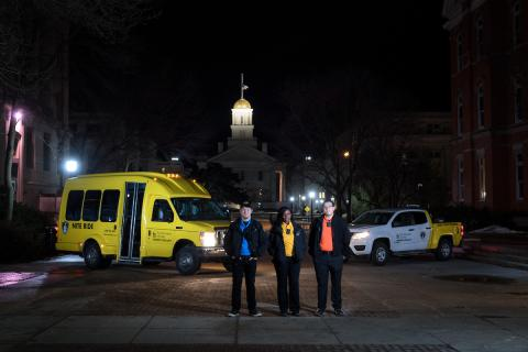 NITE RIDE and SHOUT vehicles pictured in front of the Old Capitol.