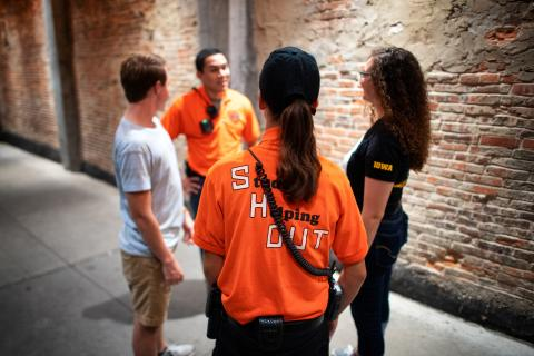 Students from the SHOUT program visit with students downtown Iowa City.