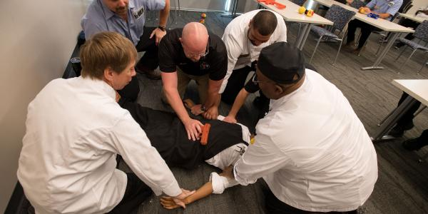 UI Police Officer demonstrating life saving techniques during a training course.