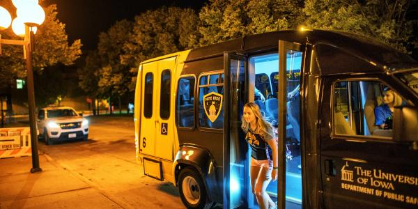 Students exit the NITE RIDE vehicle