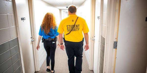 Student Security Officers patrol a residence hall on campus.