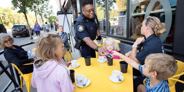 UI Police Officer Alton Poole shaking hands with members of the community during an outreach event.
